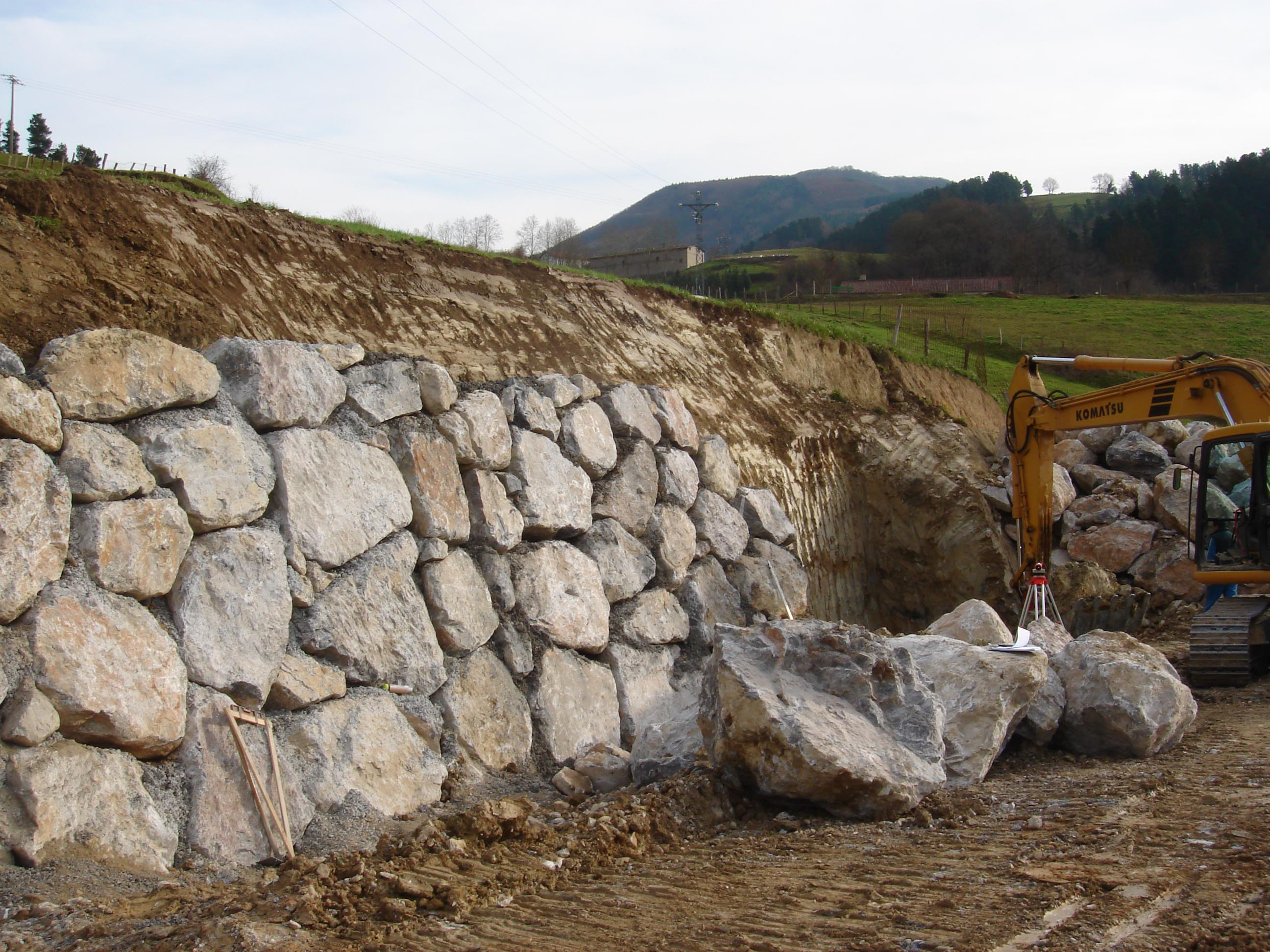 Installing retaining wall blocks